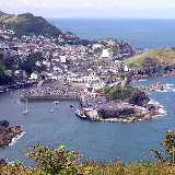 Ilfracombe seen from Hillsborough (447 feet, 136 metres). The viewpoint is on the South West Coastal Path. The Lundy ferry is the large moored boat, towards the bottom of the picture. Taken by Adrian Pingstone in July 2004 and released to the public domain.