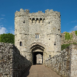 : Carisbrooke Castle gatehouse, Isle of Wight, looking in from the east. This tower, built in 1464, is a grade I listed building in England.
