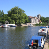 River Medway at Maidstone, Kent. A summer view towards the Archbishop's Palace taken from the River Bar & Grill terrace on The Broadway.