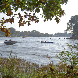 Carr Mill Dam with power boats racing