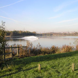 Rother Valley Park - North end. One of the difficulties of locating the photographer position on the 1940's map is that the lake wasn't there then and the river has been moved. On a crisp November morning (actually nearer 13:30), a couple of hardy souls were taking to the water on their jet skis. Brrr! The photo, looking north, looks towards Swallownest just visible in the distance.