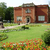 Museum and Art Gallery in Riversley Park, Nuneaton, Warwickshire. On the left of the picture is the town's Boer War monument.