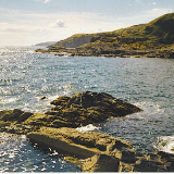 ove Bay, Looking South. This is across the entrance to the harbour which is only used nowadays by lobster boats.