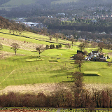 Galashiels Golf Course This is a view of the holes by the clubhouse (on the right) from Buckholm Hill in the adjoining square. The figures on the right are approaching the 2nd green, the figures in the middle are on the 1st tee, and the figures on the left are on the 8th green. Club members were playing in the March medal (01/03/08) on the course as an 18 hole layout for the final time. Rising costs and dwindling members have forced club officials to reduce the course from 18 to 9 holes. The club took over the running of the course in 1992 from the former Ettrick and Lauderdale District Council, but membership numbers have fallen over the last 10 years and fewer youngsters are taking up the game. The holes from the 10th to the 16th on the high part of the course on Blaikie's Hill will be made redundant and holes 17 and 18 will become 8 and 9. Players will commence rounds at the 3rd hole with holes 1 and 2 likely to be used as practice facilities. The club was founded in 1884 as a 9 hol