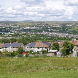 Ebbw Vale Festival Park, Blaenau Gwent. In 1992 The Garden Festival of Wales was held on a former steel works site at Ebbw Vale. Later it was regenerated as a park and now includes the Festival Park Factory Shopping Village. This is the view from the Cefn Manmoel ridge looking south towards Aberbeeg.