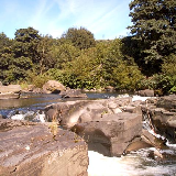 Waterfall on the Taff upstream of the disused railway bridge. View is of a waterfall on the river Taff north of the centre of Pontypridd and is used for paddling and picnicking in the summer.