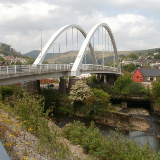 Rheola Bridge, Porth. The Rheola Bridge was made with 1,100 tonnes of structural steel. It crosses the Rhondda River at the confluence of the two Rhonddas, and the Rhondda Line railway. It was built as part of the £98 million Porth relief road project, and is one of 11 bridges that were built or replaced during the project. The relief road was opened to traffic in December 2006. Landscaping continued into 2007.