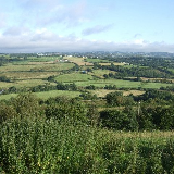 Loughor valley Taken from the Garnswllt-Pontarddulais road one morning. The river can be seen meandering in the middle distance, with the line of the railway a little closer. Plas Uchaf is the building on the far side of the valley, above and to the left of centre. Tycroes is in the far distance.