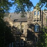 Blaenavon Workmen's Hall and Institute, dappled with shadows and framed by trees.