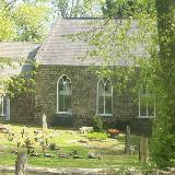 St Peter's Church in Blaenavon, seen through the churchyard trees.