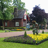 View of the South Lodge at the Hartburn Lane entrance of Ropner Park, Stockton on Tees. The floral athlete figure in the foreground commemorates the London 2012 Olympic Games.
