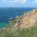 Rocky coast of Alderney. Photo taken 18 August 2004 by H. de Vegt