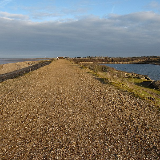 Snettisham RSPB reserve The path cuts inland to the car park at the start of the chalets.