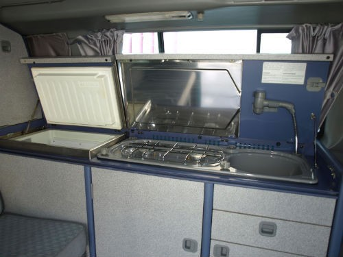 utilities  2 ring gas, sink with extendable hose, freeze/fridge, steel work surface