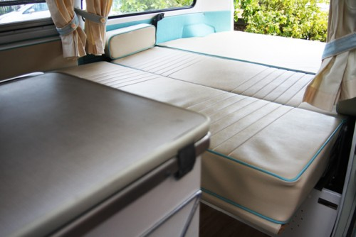 The bench seat pulls out to make the full-width double bed