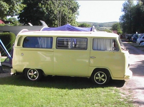 A VW T2 Classic Campervan called Petal and petal side for hire in solihull, West Midlands