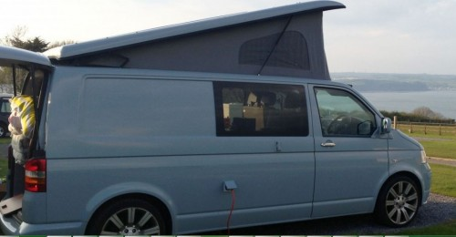 A VW T5 Campervan called BabyBlueT5 and The vans left side full view! for hire