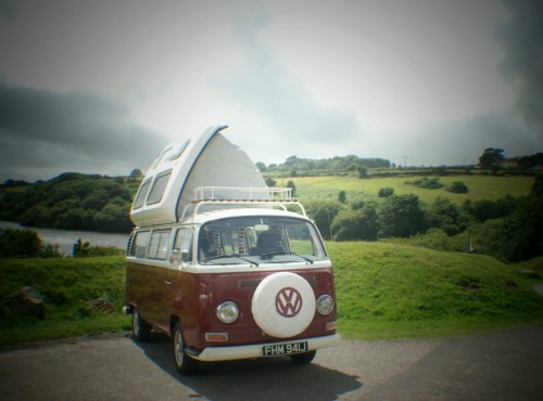 A VW T2 Classic Campervan called Ruby-Bay and Ruby with her roof up for hire in penryn, Cornwall