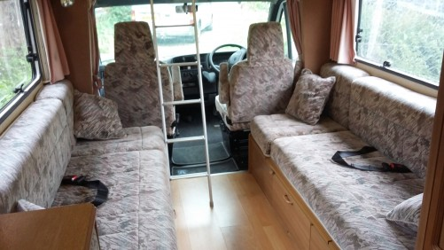 Over cab bed and rear belted seats.  4 berth motor home