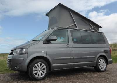 A VW T5 Campervan called SallyT5 and Sali with roof elevated for hire in airdrie, Lanarkshire