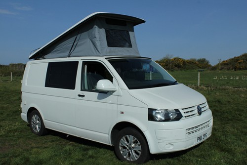 A VW T5 Campervan called BaxterN7 and Exterior with Pop up for hire in london, London