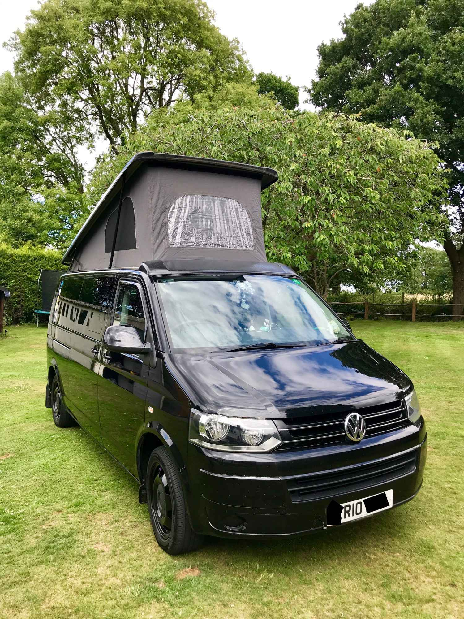 A VW T5 Campervan called Rio and for hire in send, Surrey