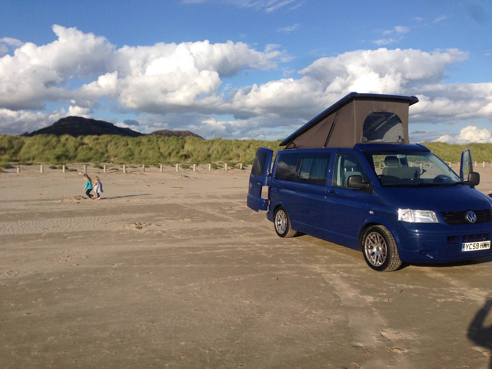 A VW T5 Campervan called Benji and A perfect day on Black Rock sands, North Wales for hire