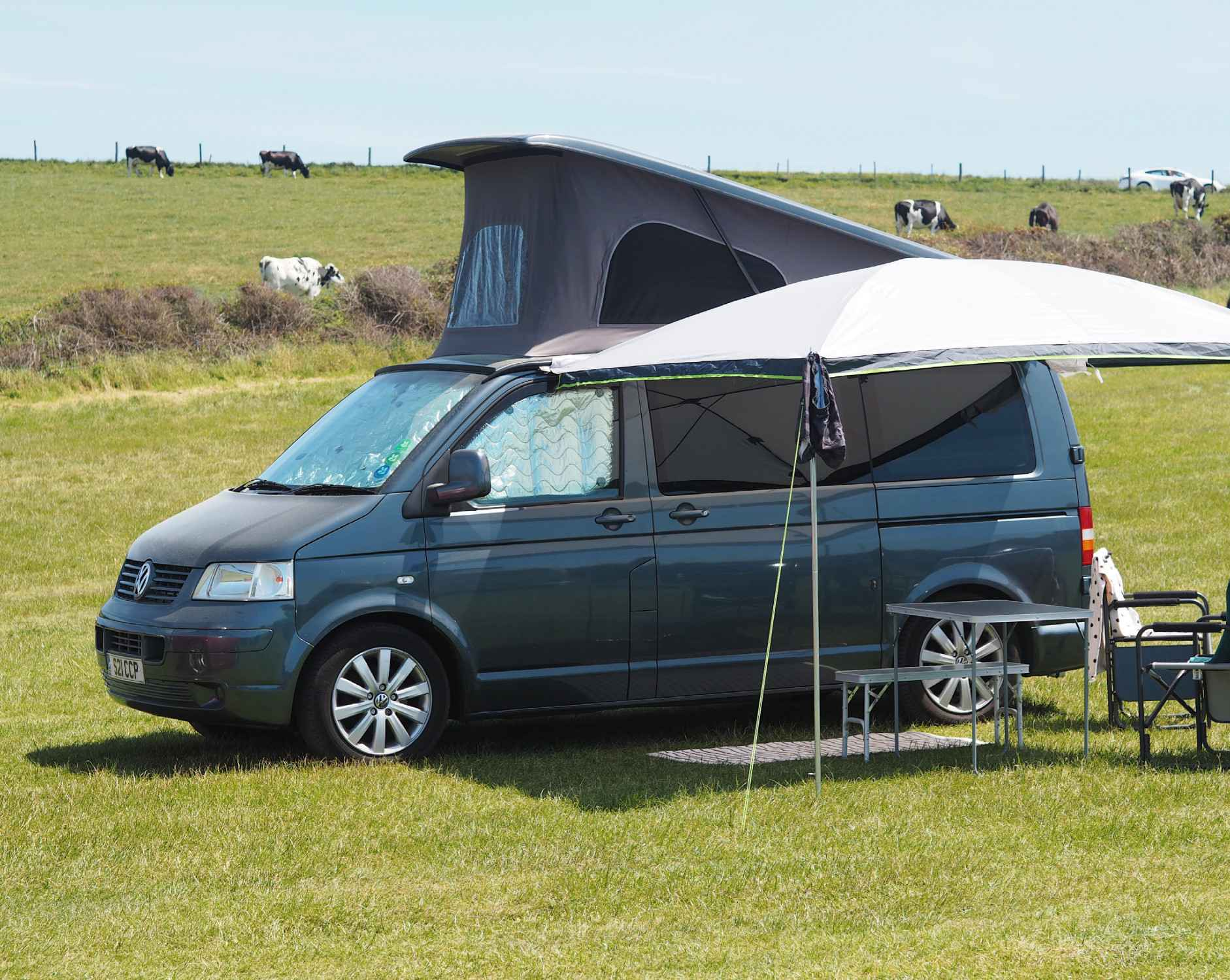 A VW T5 Campervan called rosie and Reimo Sun Canopy with picnic set up for hire in South Croydon, Surrey